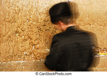 Traditional Hassidic Man Praying at the Western Wall moving...