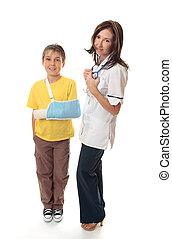 Medical officer with injured child - Medical officer stands...