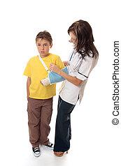 Nurse assisting an injured boy - Nurse or healthcare officer...