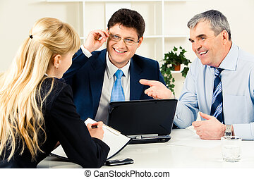 Conversation - Photo of three successful business people...
