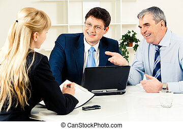 Consulting - Three business partners discussing new working...