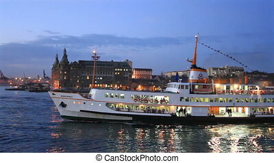 Night at Kadikoy, Istanbul - Beautiful passenger ship sails...