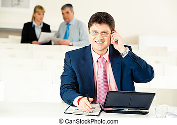 Busy entrepreneur - Portrait of confident man calling on his...