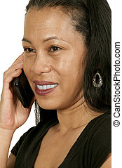 Woman on the Phone - Latino Hispanic miiddle age woman using...