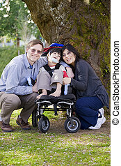 Disabled child surrounded by parents - Happy disabled child...