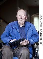 Elderly man in wheelchair at his front door