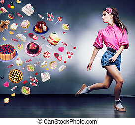 Happy shopper woman running in studio. Advertising concept