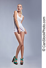 Fashion young sensual woman in singlet - erotic pose -...