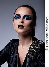 Beautiful fashion arrogant woman with blue eyes make-up -...