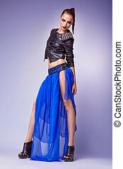 Portrait of young modern female in blue fashion gown dress