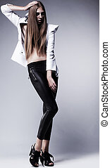 Young woman in black leggings posing. Glamour, beauty style...