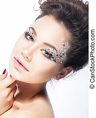 Young beauty woman face. Bright coiffure and make-up - Young...