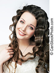 Fashion smiling bride in wedding white dress - curly hairstyle