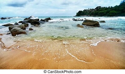 Sea surf in a tropical bay. Thailan