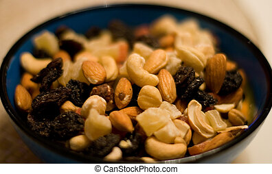 mixed nuts and dried fruits - bowl of mixed nuts and dried...