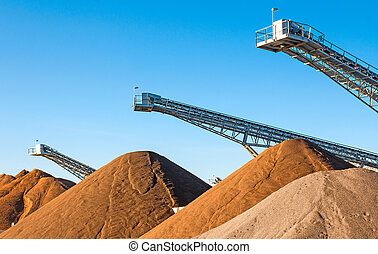 Mining Industry - Conveyors and gravel heap at an industrial...