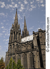 Side View of the Cathedral of Clermont-Ferrand with a blue...