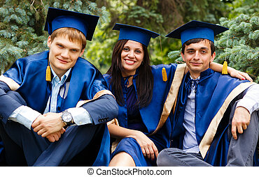 Image of happy young graduates - outdoor shot