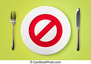 Empty plate with restricted red sign on it - dieting concept...