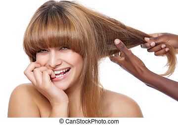 Smiling beauty getting her hair done - Beautiful happy woman...