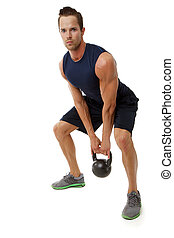 Kettle bell exercise - Young attractive male doing kettle...