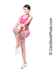 Fit woman holding her leg to warm up before sport isolated...