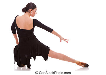 beautiful salsa dancer posing in a lunge - back view of a...