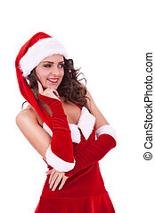 pensive young xmas woman - young christmas woman looking...