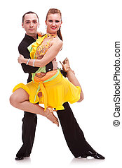 beautiful salsa dance couple posing while the man is holding...