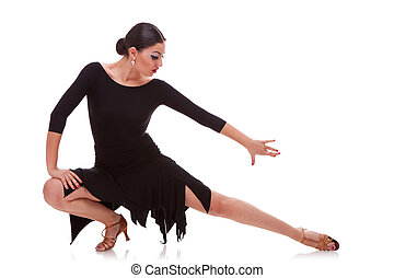 woman salsa dancer in a lunge pose - portrait of a young...