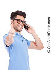 young man on the phone thumbs up - Smart young casual man...