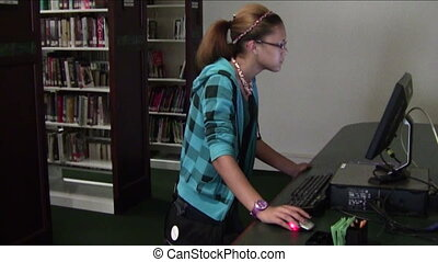 Library Research - High school student doing library...