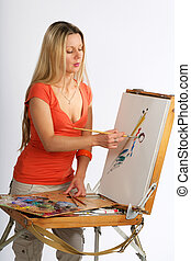 Blonde artist - Young blonde long hair artist painting a...