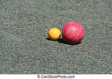Red bocce ball near the pallino - A Red bocce ball near the...