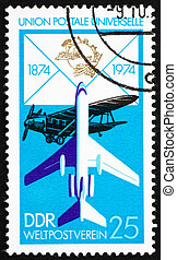 Postage stamp GDR 1974 Biplane and Jet - GDR - CIRCA 1974: a...