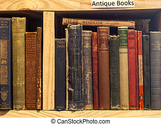 Second-hand bookstore shelf antique books segment horizontal...