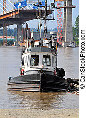 tugboat tied at pier