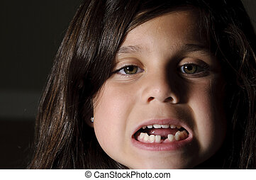 lost my tooth - a 6 year old girl smiling and showing off...