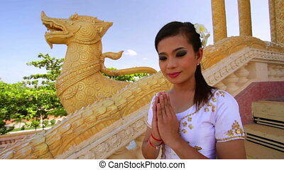 Asian Girl Greeting in Temple