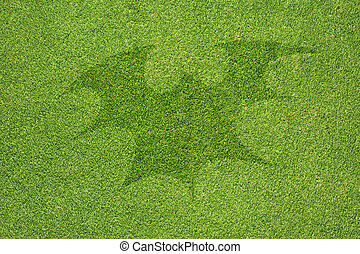 Halloween bat on green grass texture and  background