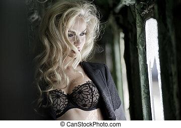 Blonde beauty posing in train