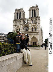 Tourists near Notre Dame de Paris - Group of tourists,...