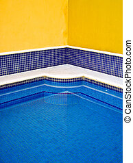 Mexican tiled pool - Blue tile pool with yellow walls