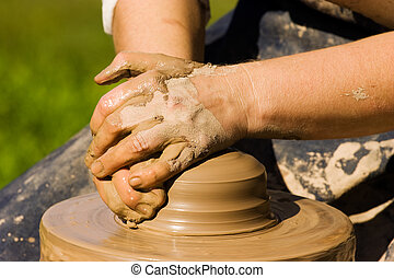 Potters hands starting to make new ceramic object