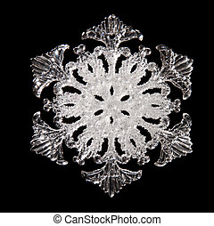 Snowflake shape, photo on the black background