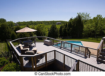 Modern deck and swimming pool - Modern wooden deck with...