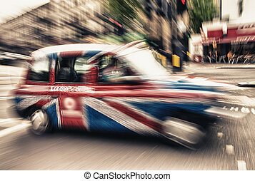 UK cab in London, Motion blur effect.