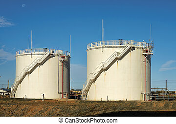 Oil storage tanks. - Vertical steel tanks for the storage of...