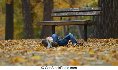 Indian summer - Running seven year old boy throws autumn...