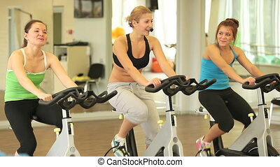 Healthy life - Slim young women with instructor training on...